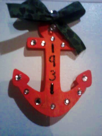 Younger sister made me this. Hunter orange anchor with rhinestones, my Bond number and camo bow. She knows me too well. TSM.