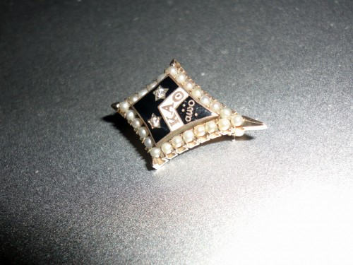 He gave me.his grandmother's Theta badge from the '40s with real pearls and diamonds. TSM.