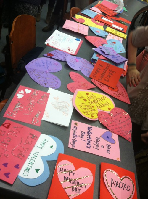 Sisterhood bonding while crafting V-Day cards for children in the hospital. TSM.
