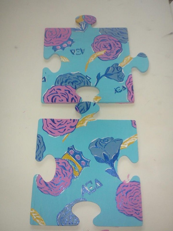 Painting your Lilly print on your philanthropy symbol. TSM.