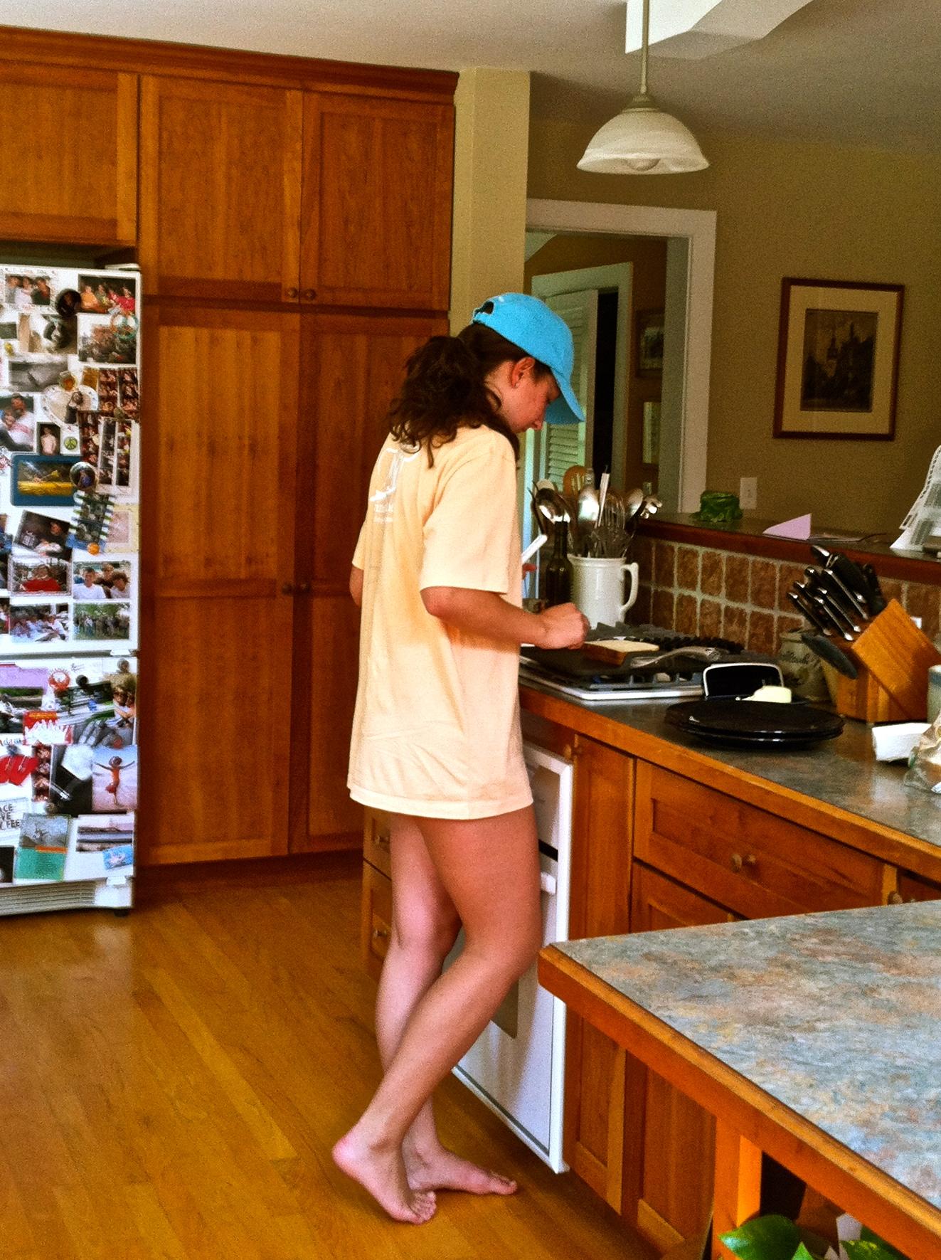 Cooking in a Vineyard Vines hat, shirt, and USA bikini. TSM.