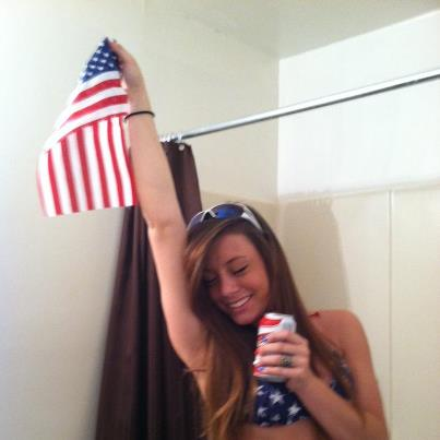 Beer in one hand, American flag in the other. TSM.