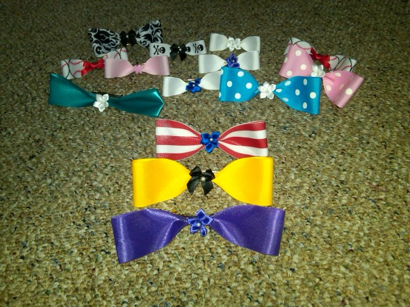 I have lots of bows, but these three are my favorite: one for my sisters, one for my school and one for my country. TSM.