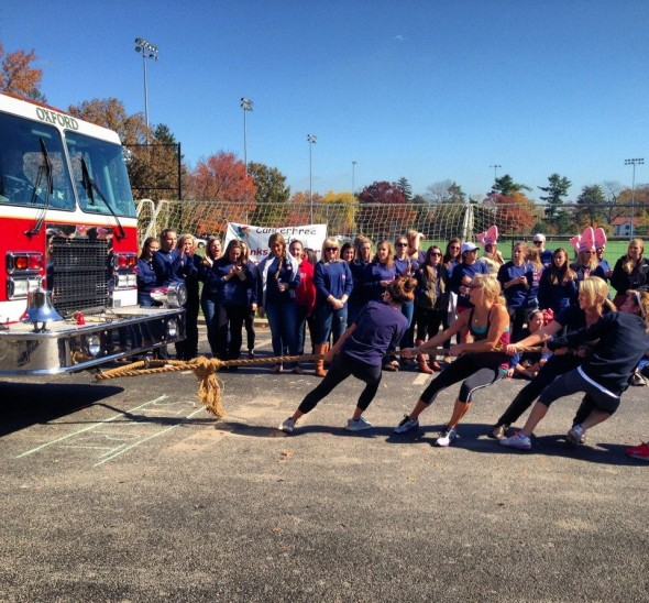 Alpha Phi pulling a fire truck for philanthropy. TSM.