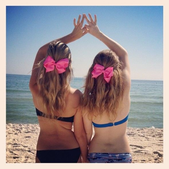 Beaches, bows, and sisters. TSM.