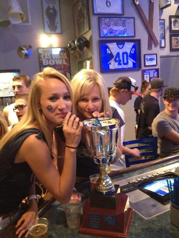 Drinking out of the Homecoming Trophy. TSM.