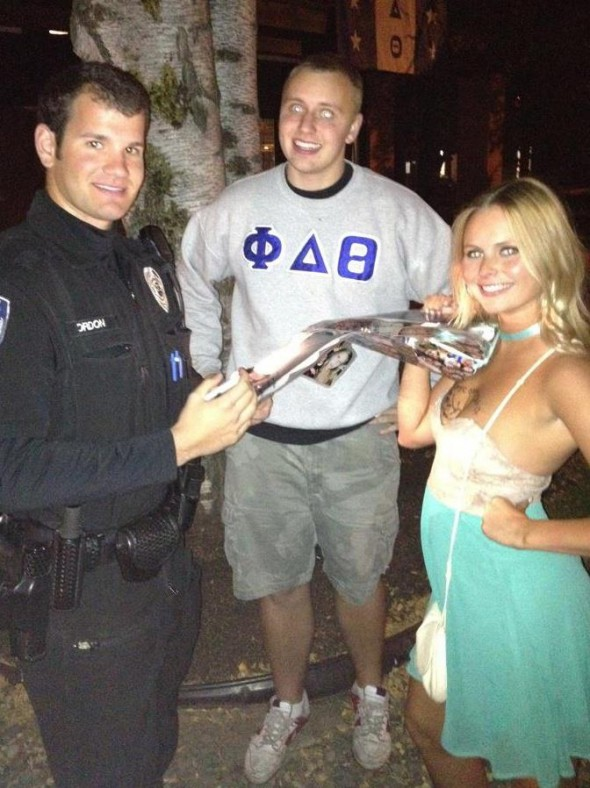 Hot cop signing your birthday sign. TSM.