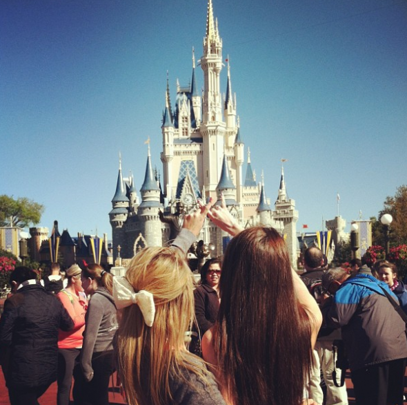 Big and Little in front of Cinderella's castle. TSM.