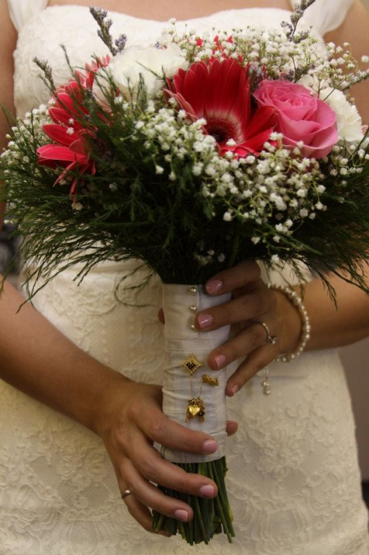 My pin on my big's bouquet for her something borrowed BEFORE it was cool. TSM.