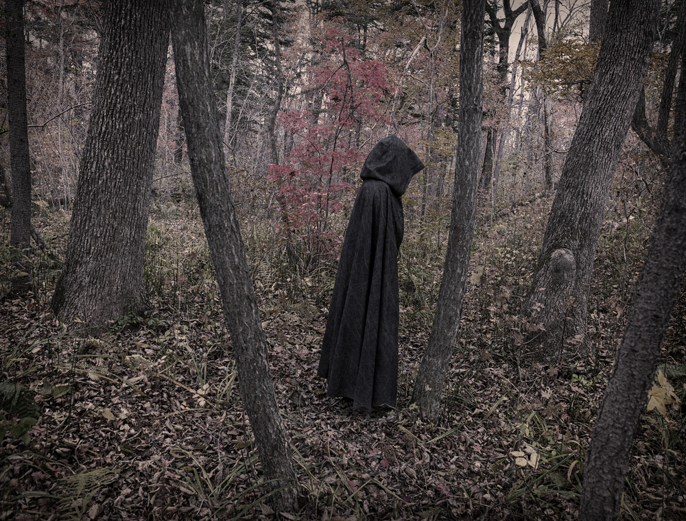 What's With This Creepy Cloaked Figure Lurking Outside NC Apartments With Raw Meat?