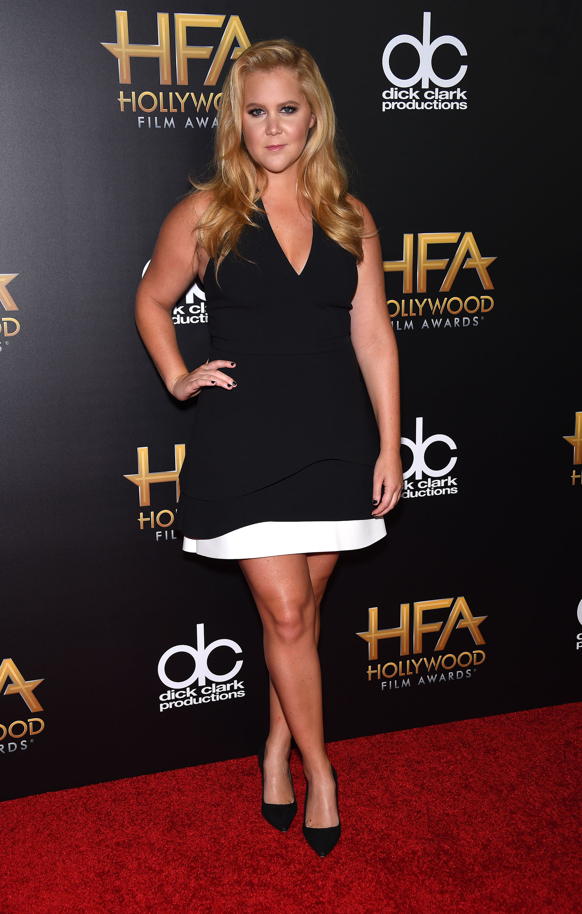 amy schumer poses in spanx