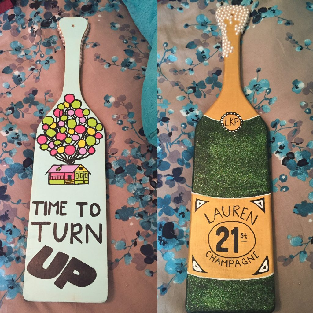 Painted sorority paddles