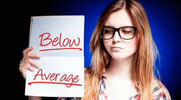 girl holding paper below average