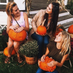 sorority girls holding pumpkins