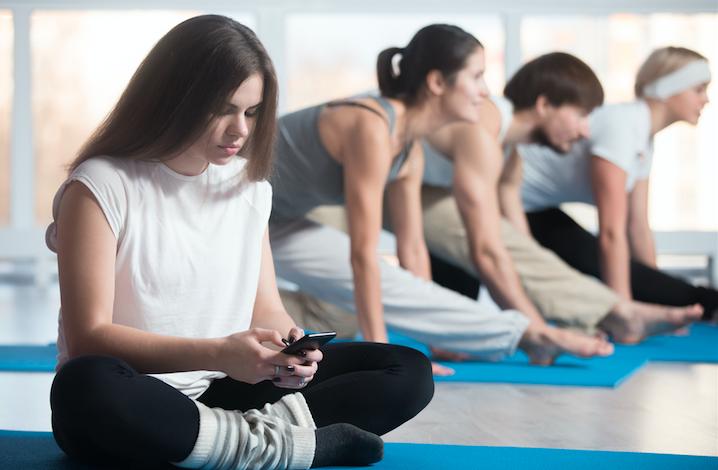 Girl in yoga class hating life