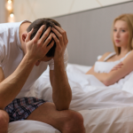 couple in bed upset