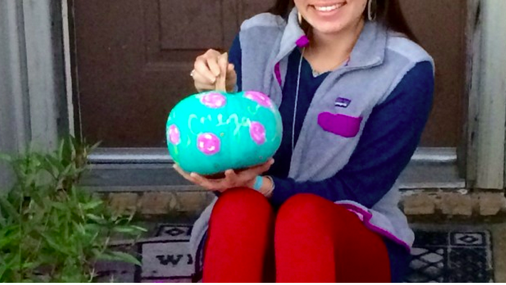 girl with painted pumpkin
