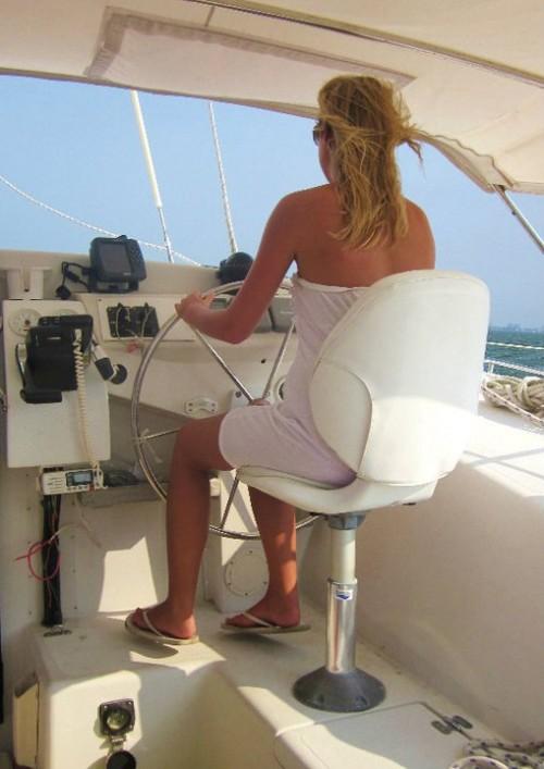 Taking a turn at sailing the yacht. TSM.