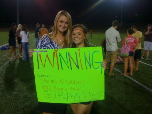 Still in pin attire from the meeting, but she ran on the field with a sign in one hand and her heels in the other. TSM.