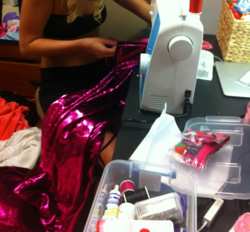 Whipping out the sewing machine to perfect the pink, sparkly toga. TSM.