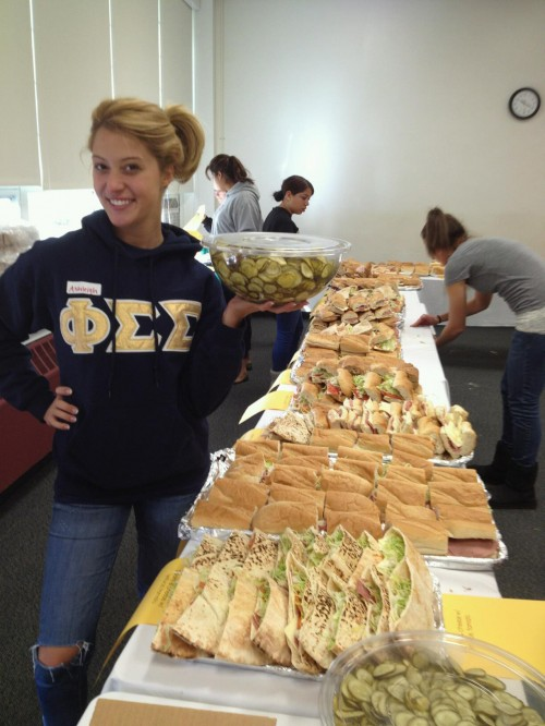 Pickle girl at the annual sandwich making convention. Always a hit. TSM.