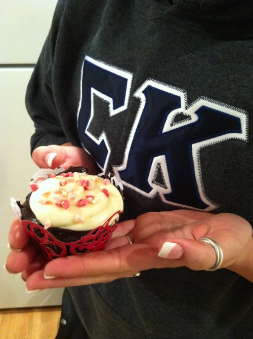 Chocolate cupcakes with fudge, peppermint frosting, and candy cane sprinkles. TSM.