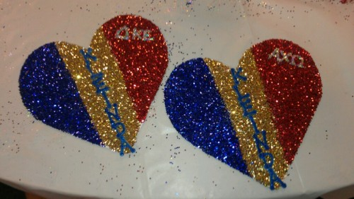 Crafting his crush party heart to match his fraternity's flag. TSM.