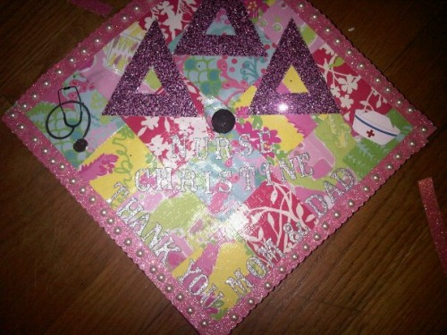 My graduation cap made from my old Lily planner with some of the most important dates/events while in college. TSM.