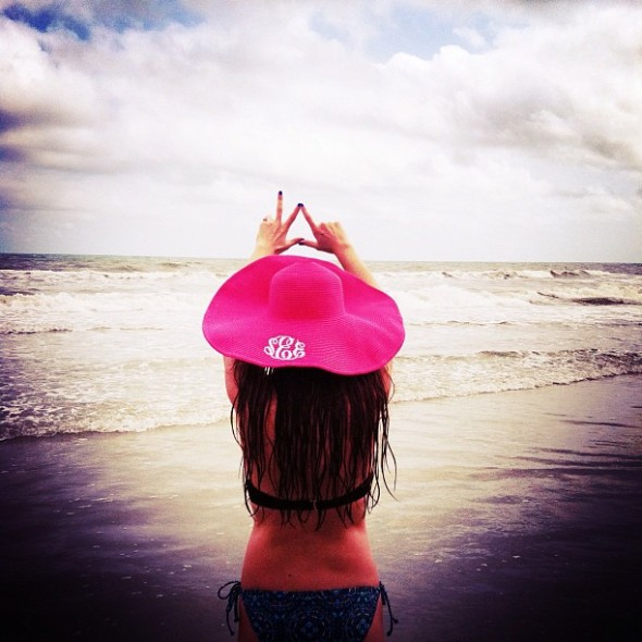 Making sure everyone at the beach knows you're a sorority girl. TSM.
