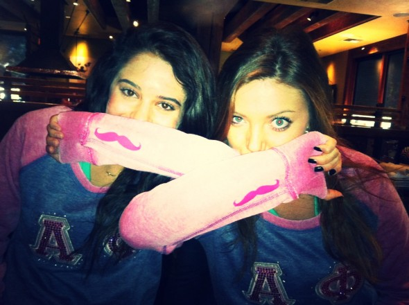 Big and Little enjoying their unique letters on initiation. TSM.