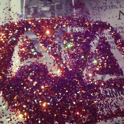 Not being able to resist writing your letters in the leftover glitter. TSM.