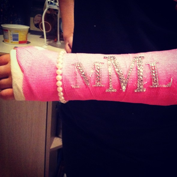 Having a monogrammed, bedazzled cast with a pearl strand. TSM.