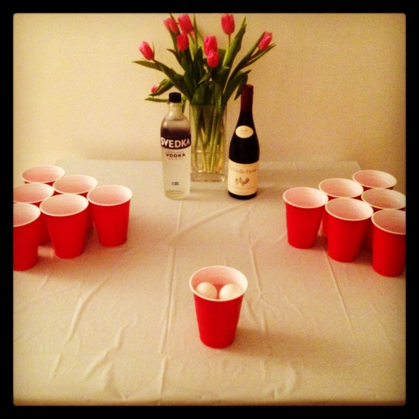 Flowers, vodka and wine on the pong table at the pregame. TSM.
