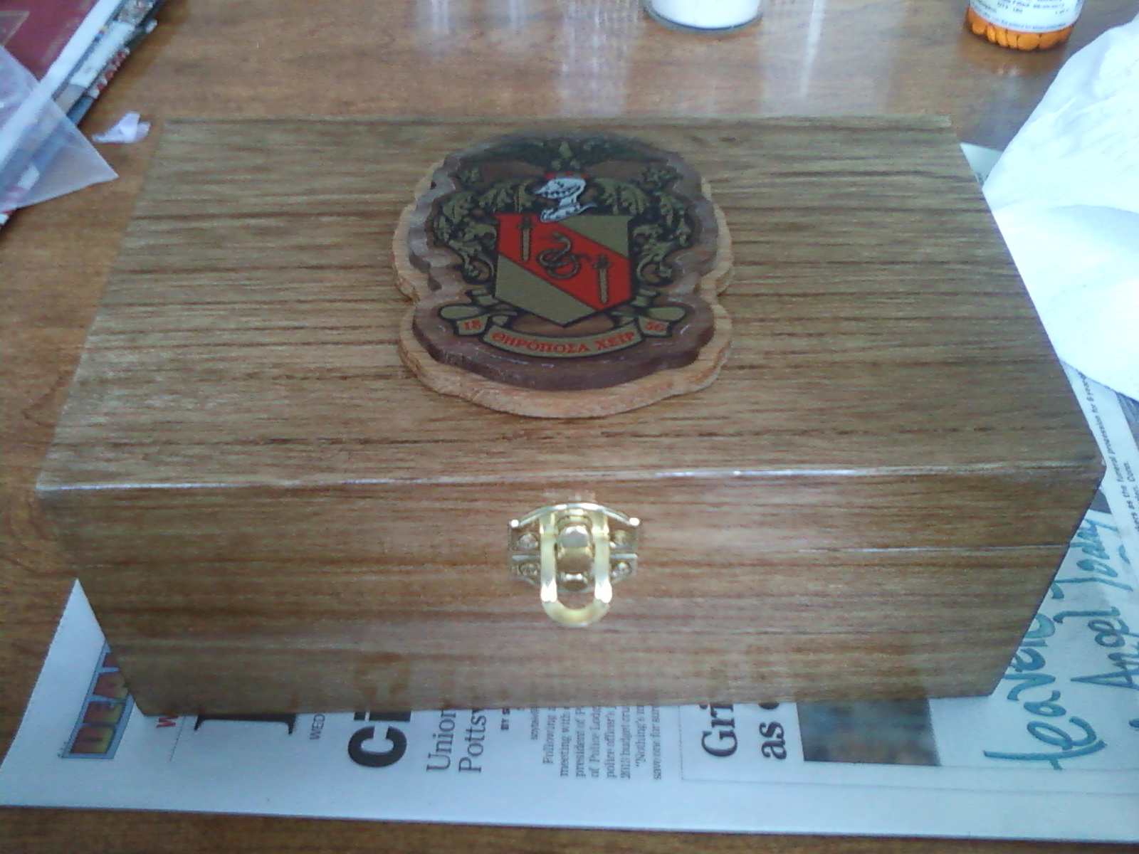 Hand crafting a Theta Chi president's box as part of your First Lady duties. TSM.
