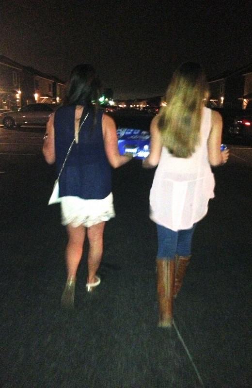 Sisters help sisters carry their 24-packs. TSM.