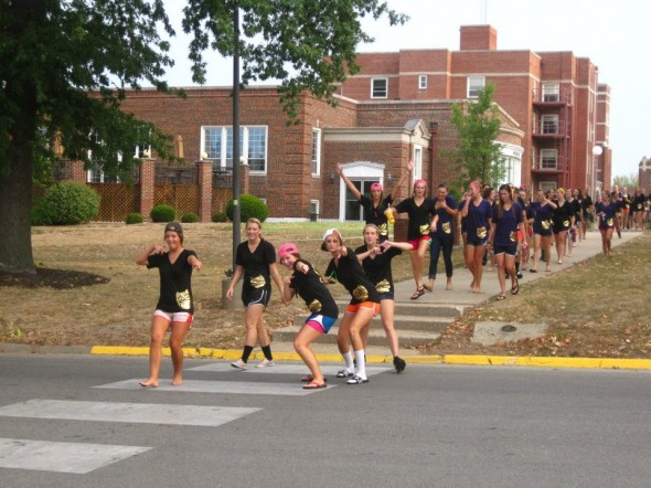 The parade of sisters back to the house on bid day. TSM.