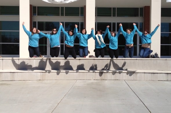 Automatically doing a jumping picture when we are all wearing the same shirt. TSM.