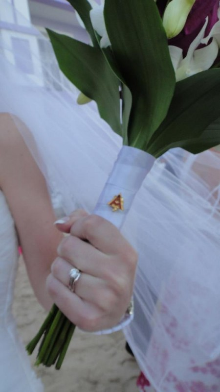 My biological and sorority sister wearing my pin on her bouquet as her something borrowed. TSM.