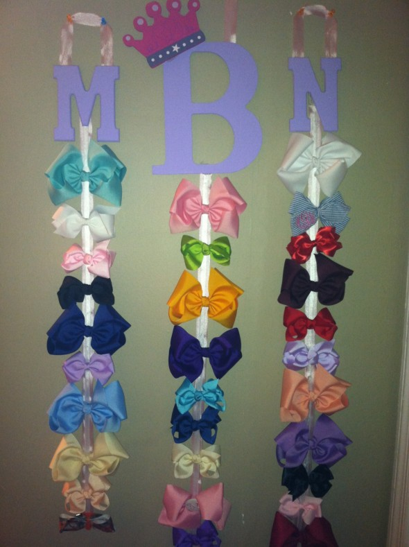 Got engaged to the man of my dreams and the first thing I made with my new monogram was a bow holder. TSM.