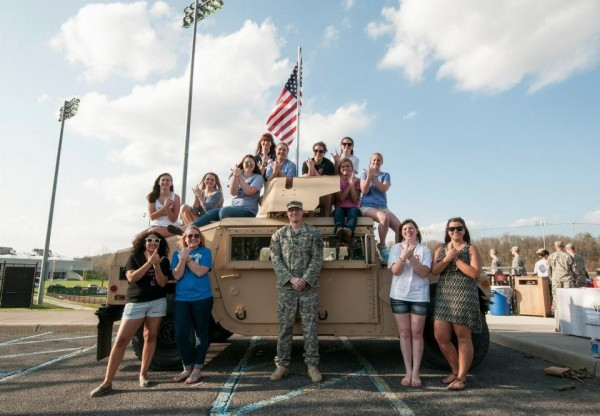 Throwin' what we know on top of a Humvee with the stars and stripes in the background. TSM.