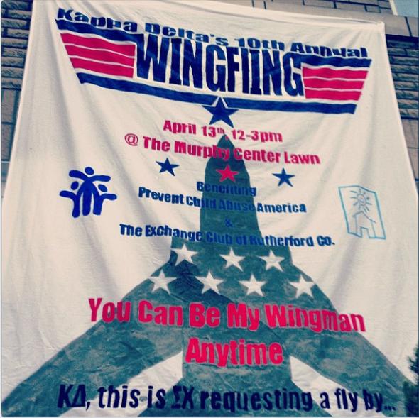 Top Gun-themed sorority philanthropy banner. TSM.