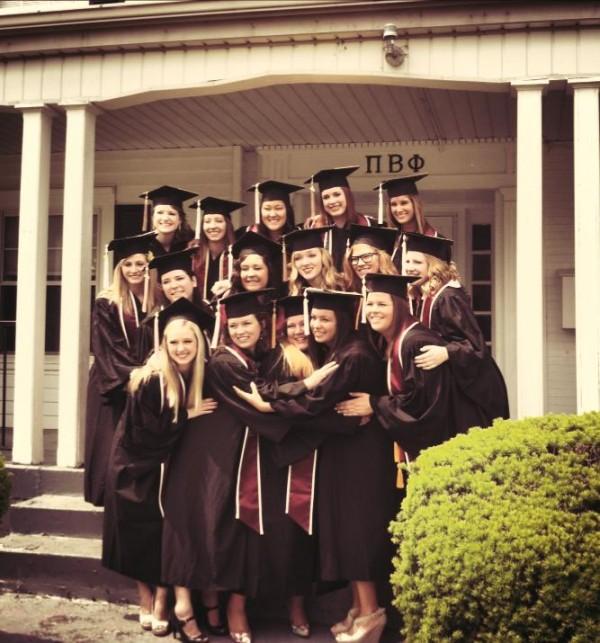 Perfecting the 'hugging photo' on Graduation Day. TSM.