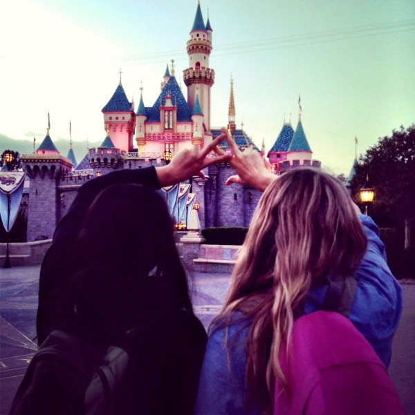 Big and little throwin what we know at the happiest place on earth. TSM.