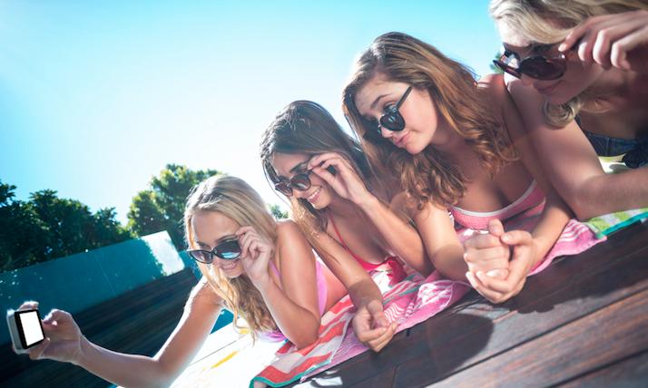 girls on a dock taking a selfie